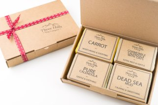 craft boxes with red ribbon and soaps