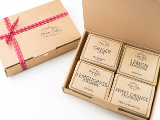 open and closed boxes with handmade soaps
